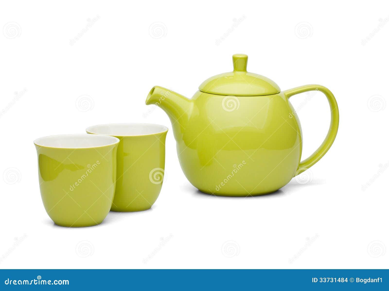 Бак зеленого чая при установленные чашки чая