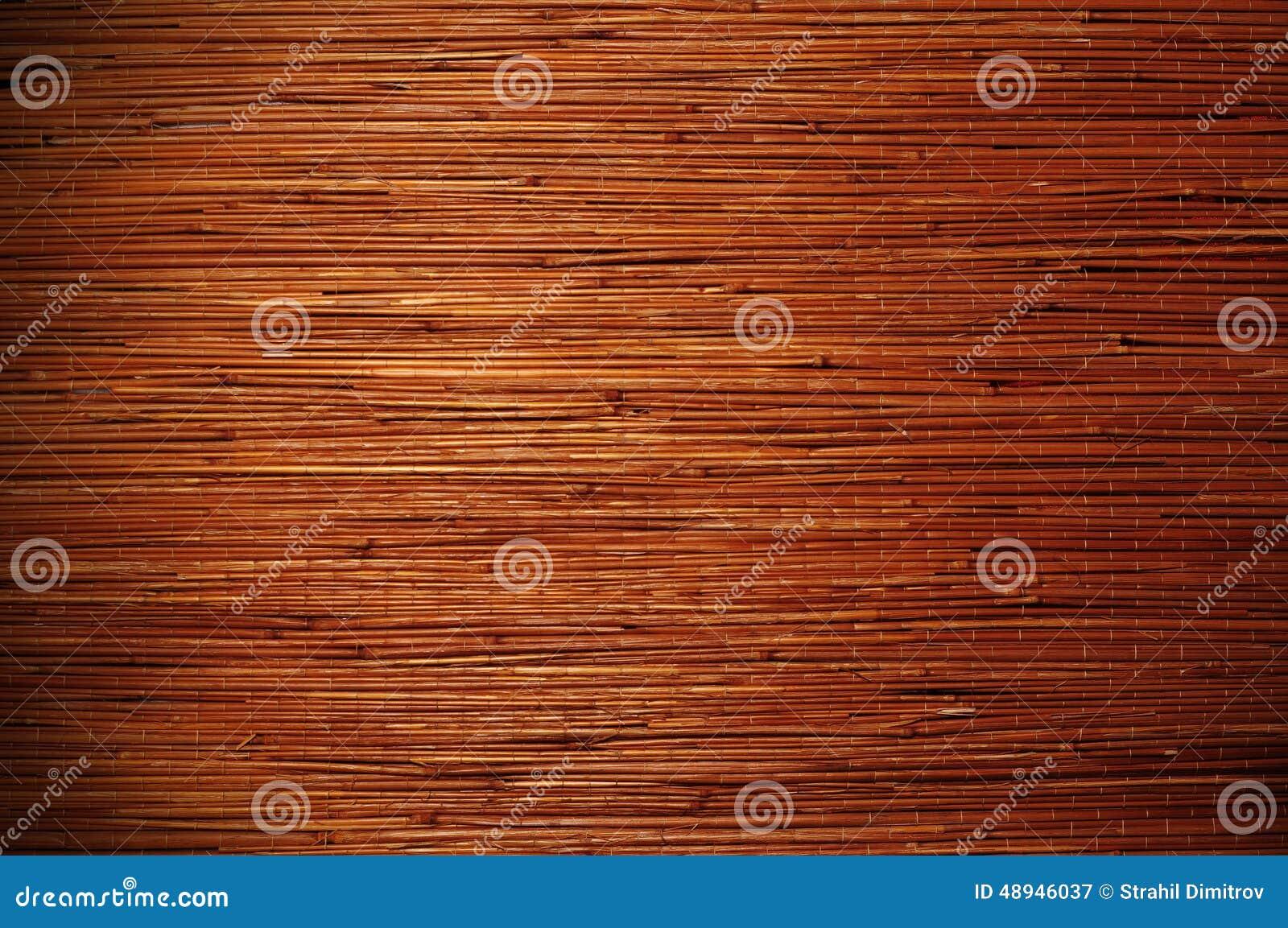 Бамбуковая коричневая циновка соломы как предпосылка текстуры