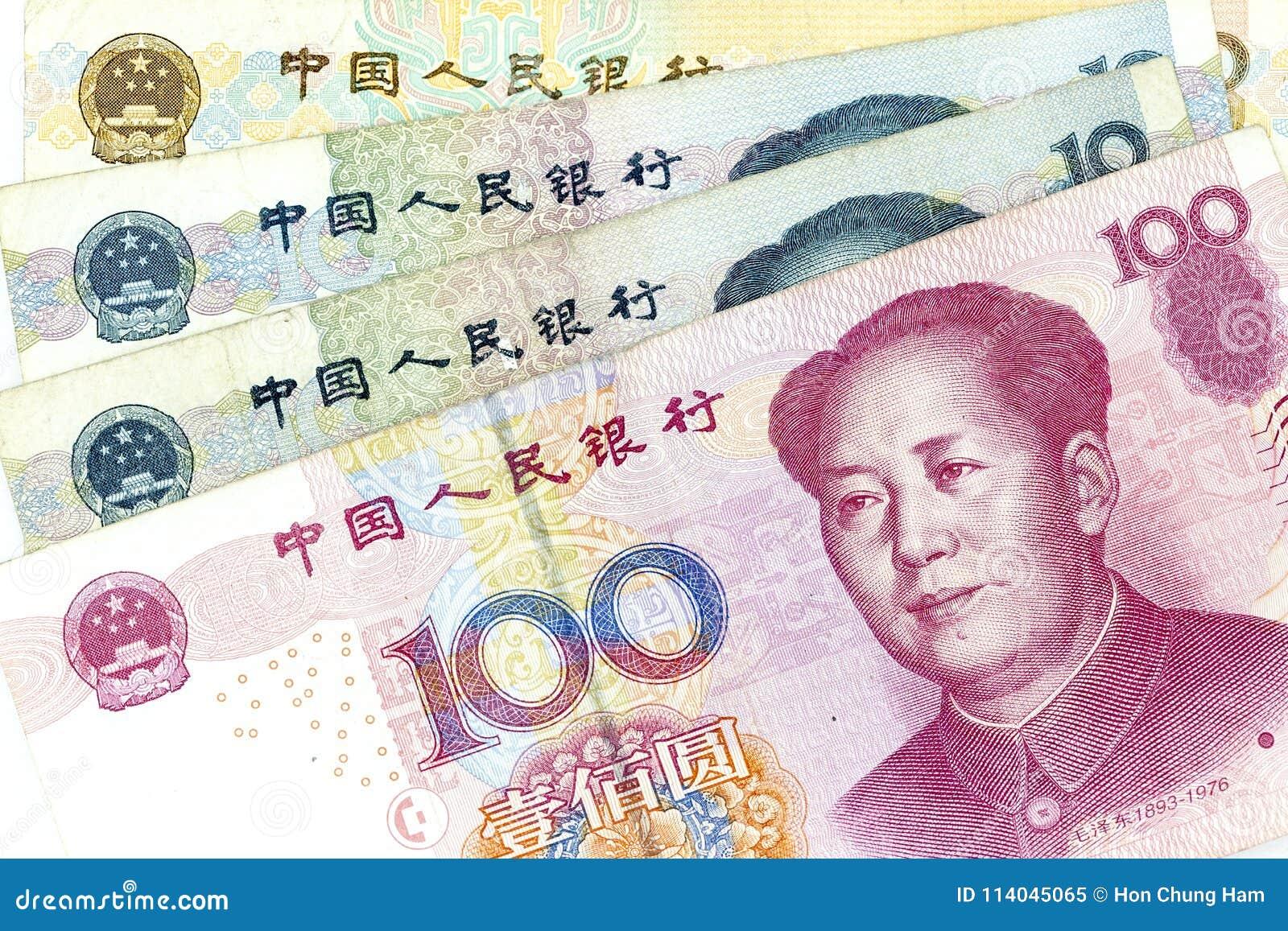 Банкноты валюты распространили через фарфор renminbi рамки в различной деноминации