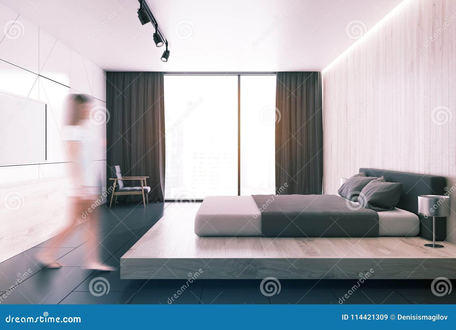 Белая спальня просторной квартиры с телевизором тонизированный взгляд со стороны
