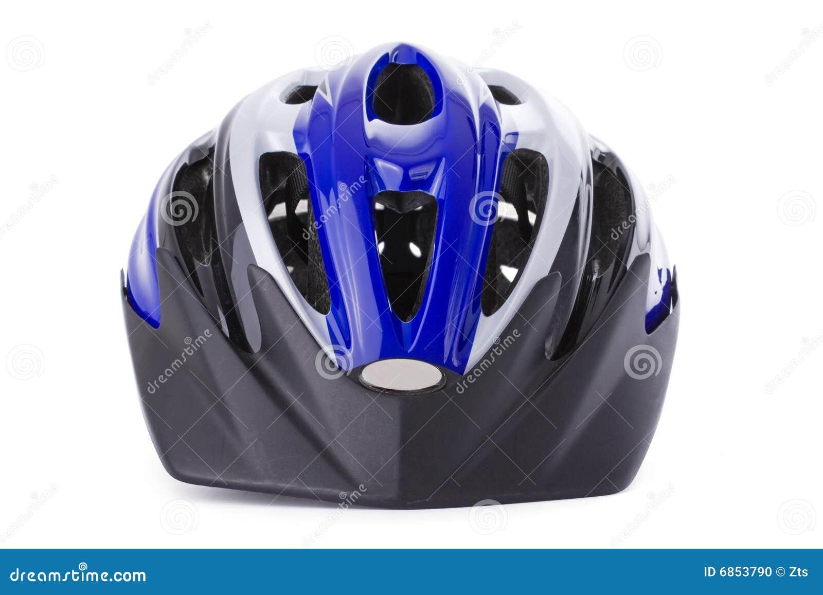 белизна велосипеда изолированная шлемом