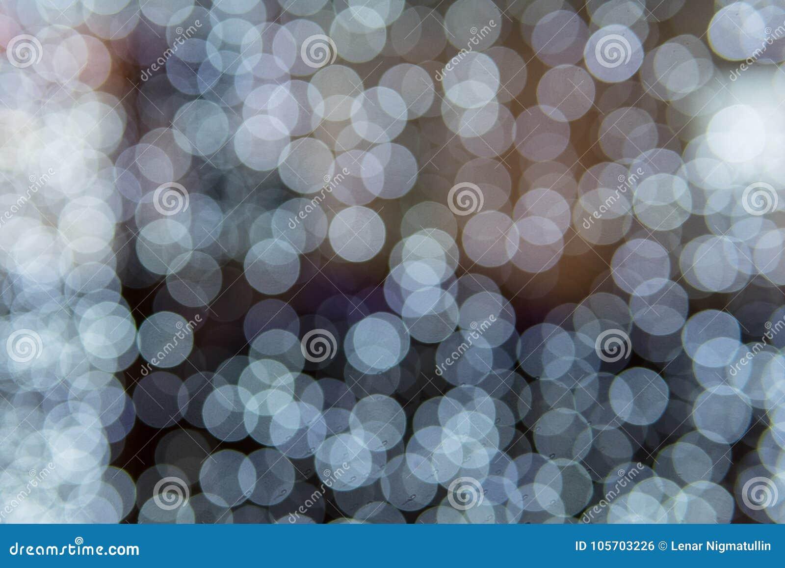 Белые светы нерезкости, текстура defocused точек абстрактная