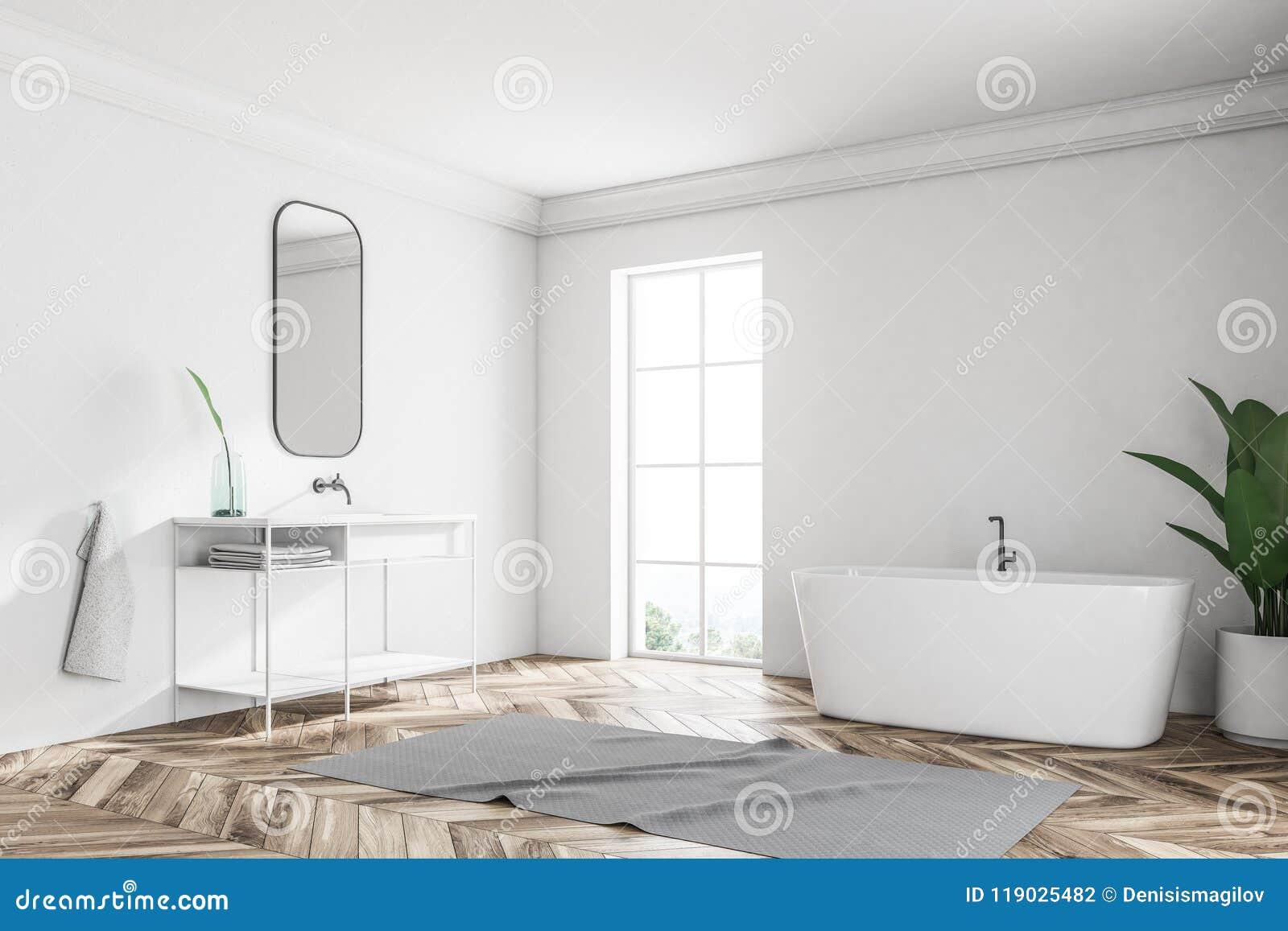 Белые угол, ушат и раковина ванной комнаты просторной квартиры