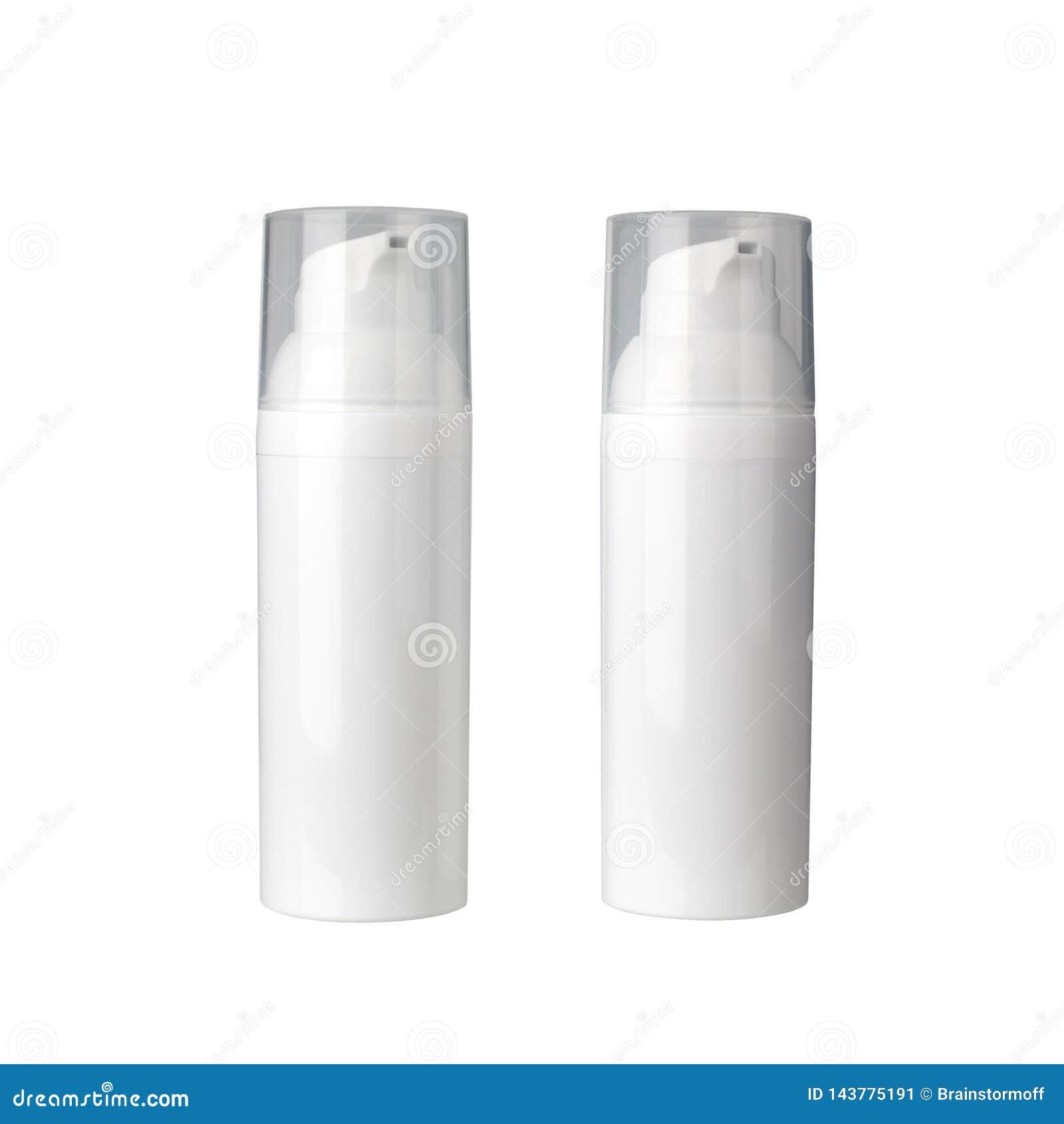 2 белых косметических бутылки сливк с распределителем на белой крупном плане изолированном предпосылкой, бутылке сливк стороны с