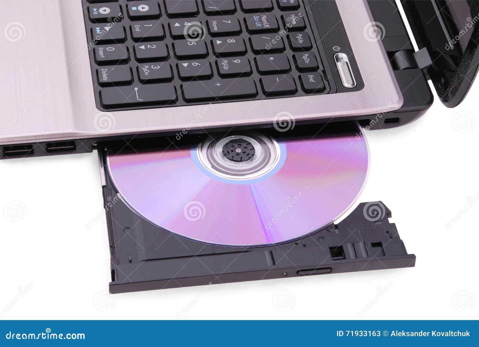 белизна компьтер-книжки предпосылки Диск DVD в приводе
