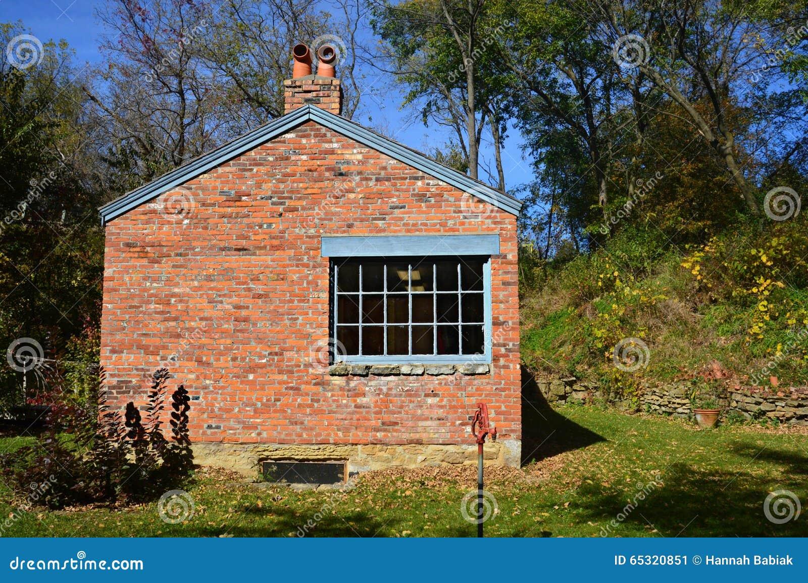 белизна структуры дома кирпича предпосылки