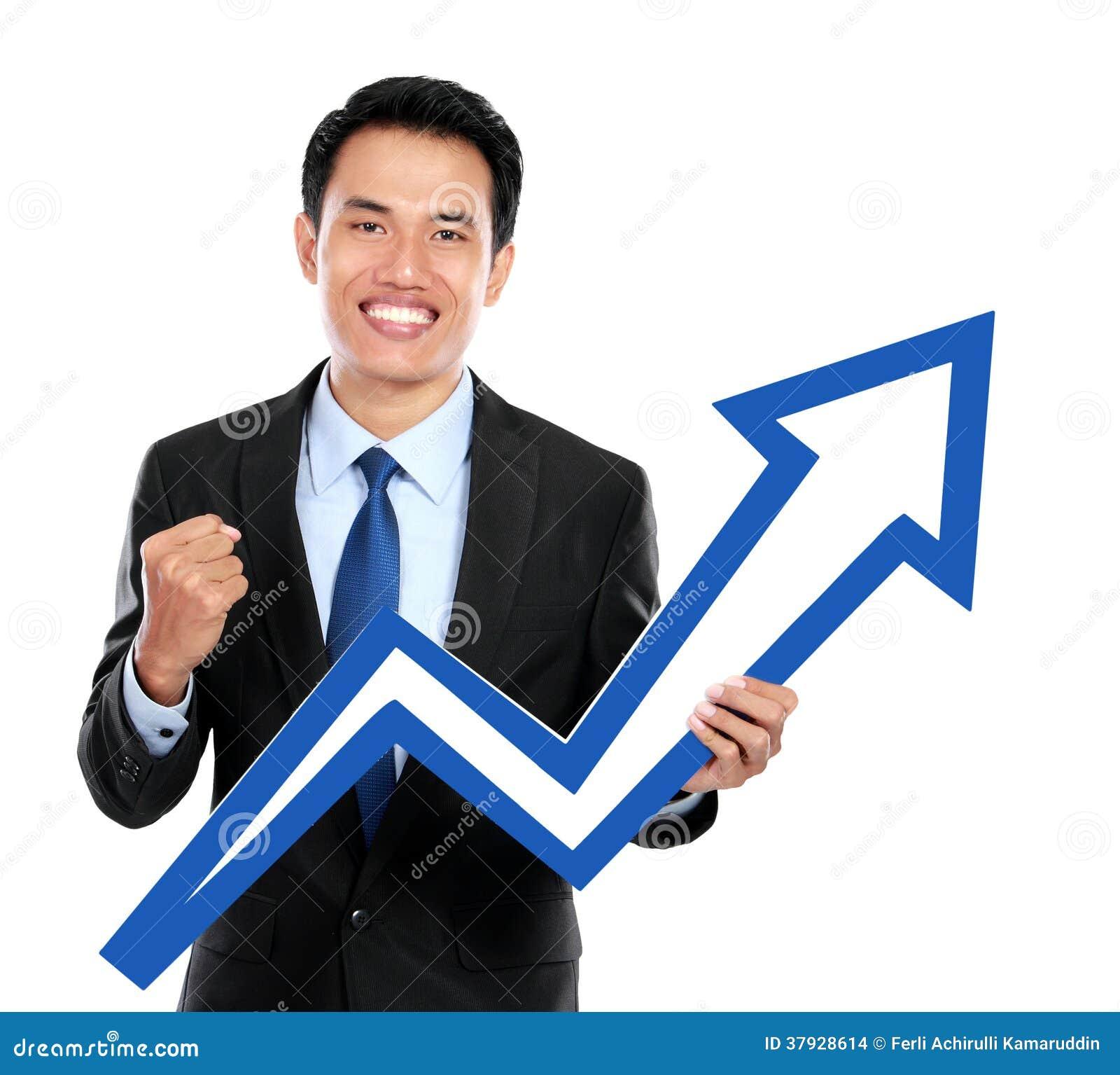 Бизнесмен с поднимающим вверх символом диаграммы в руке