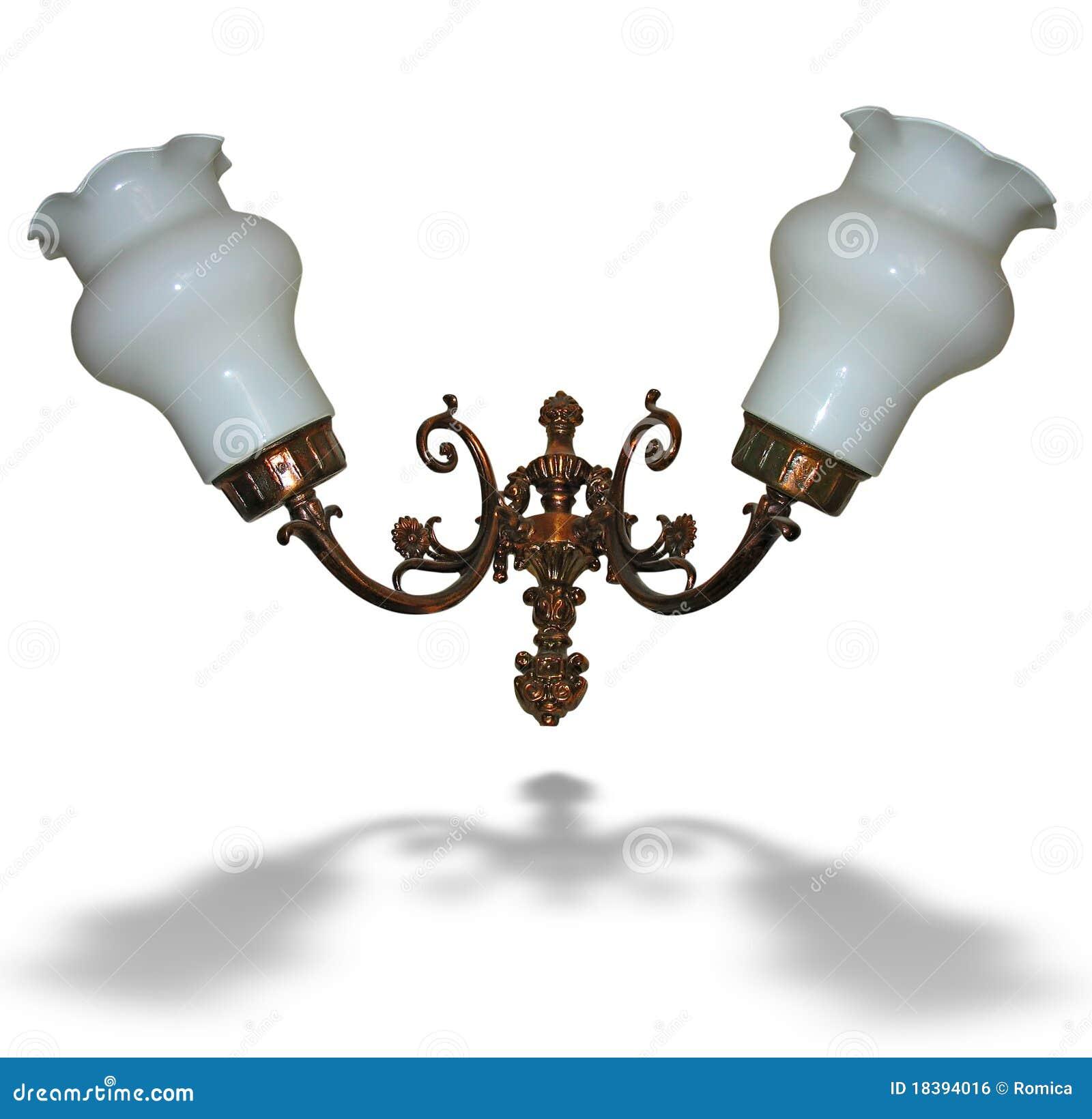 бронзовый электрический изолированный светильник над белизной стены
