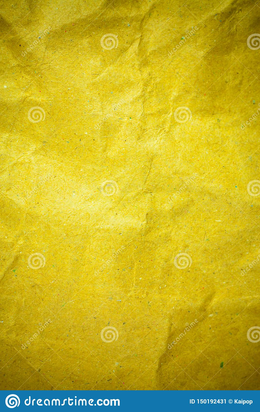 Бумага желтой виньетки скомканная