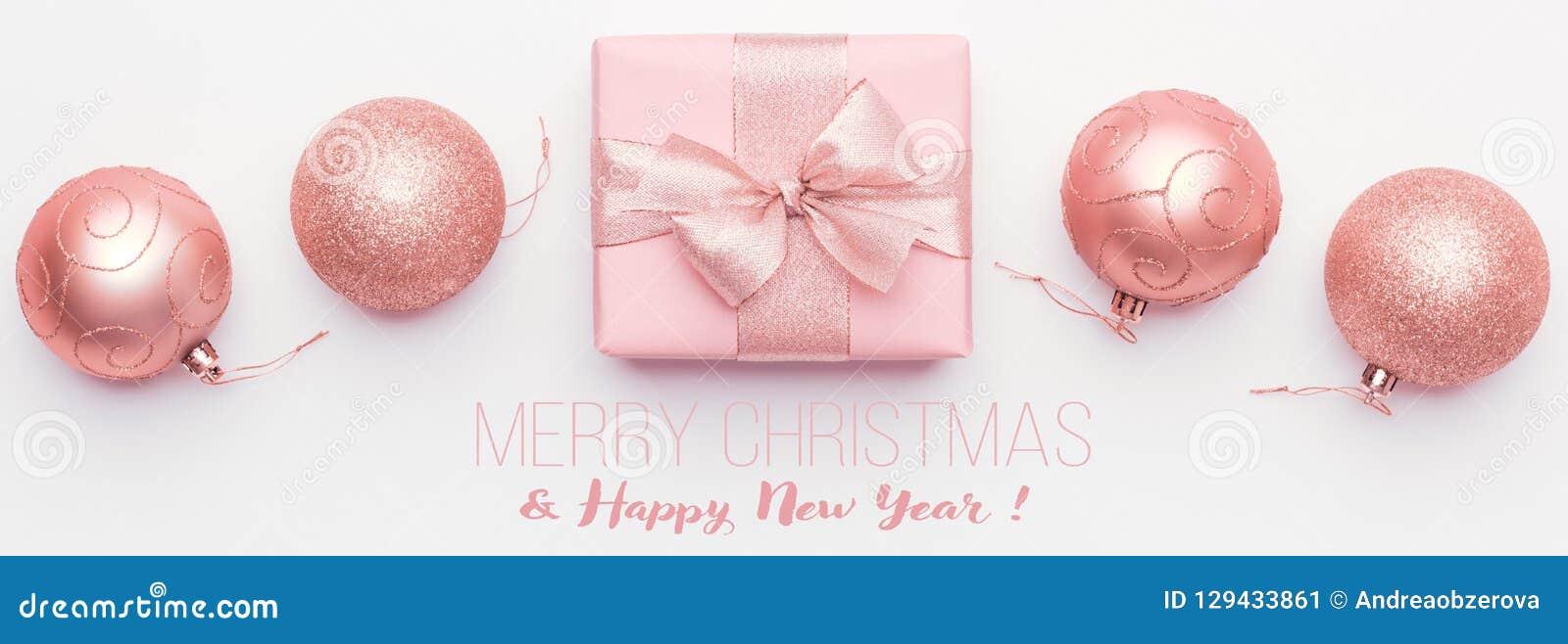 вектор иллюстрации рождества eps10 знамени Красивые розовые безделушки подарка и орнамента рождества изолированные на белой предп