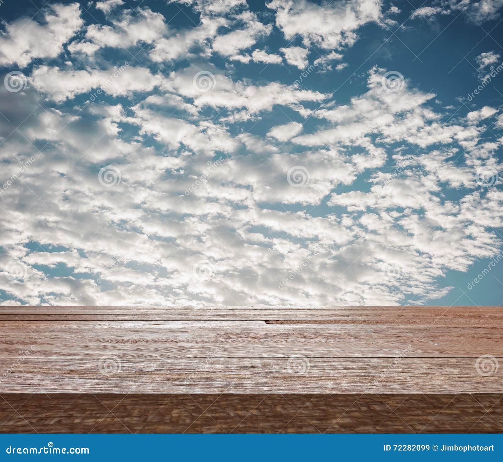 Download Верхняя часть деревянного стола на голубом небе с облаком Стоковое Изображение - изображение насчитывающей пасмурно, cloudscape: 72282099