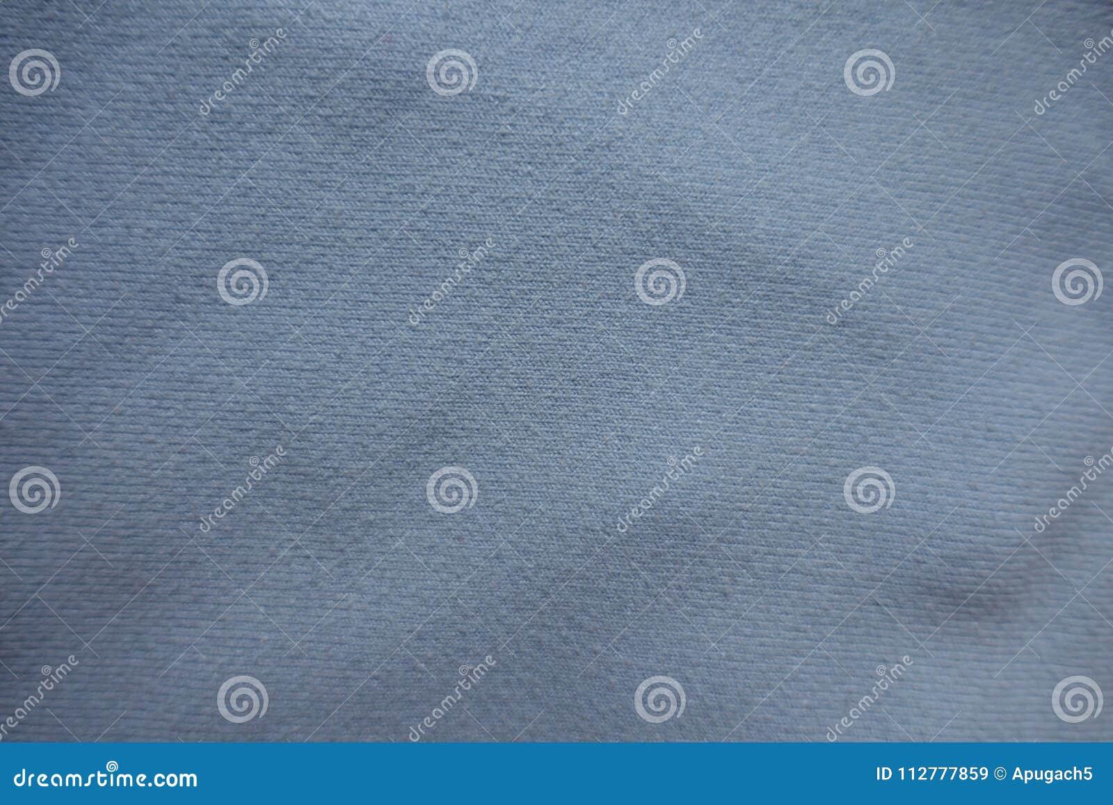 Взгляд сверху небесно-голубой ткани
