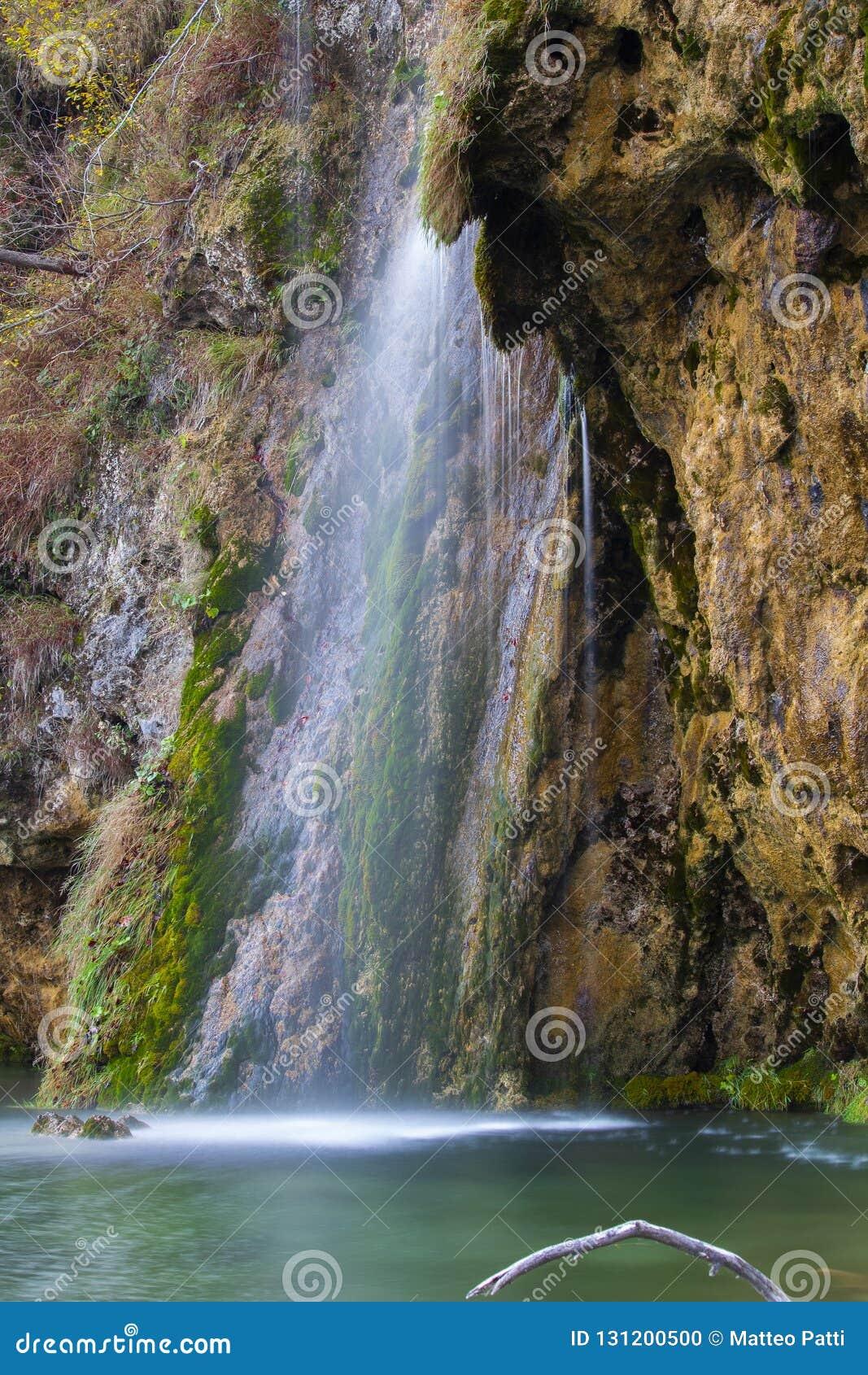 Внушительный маленький и милый водопад