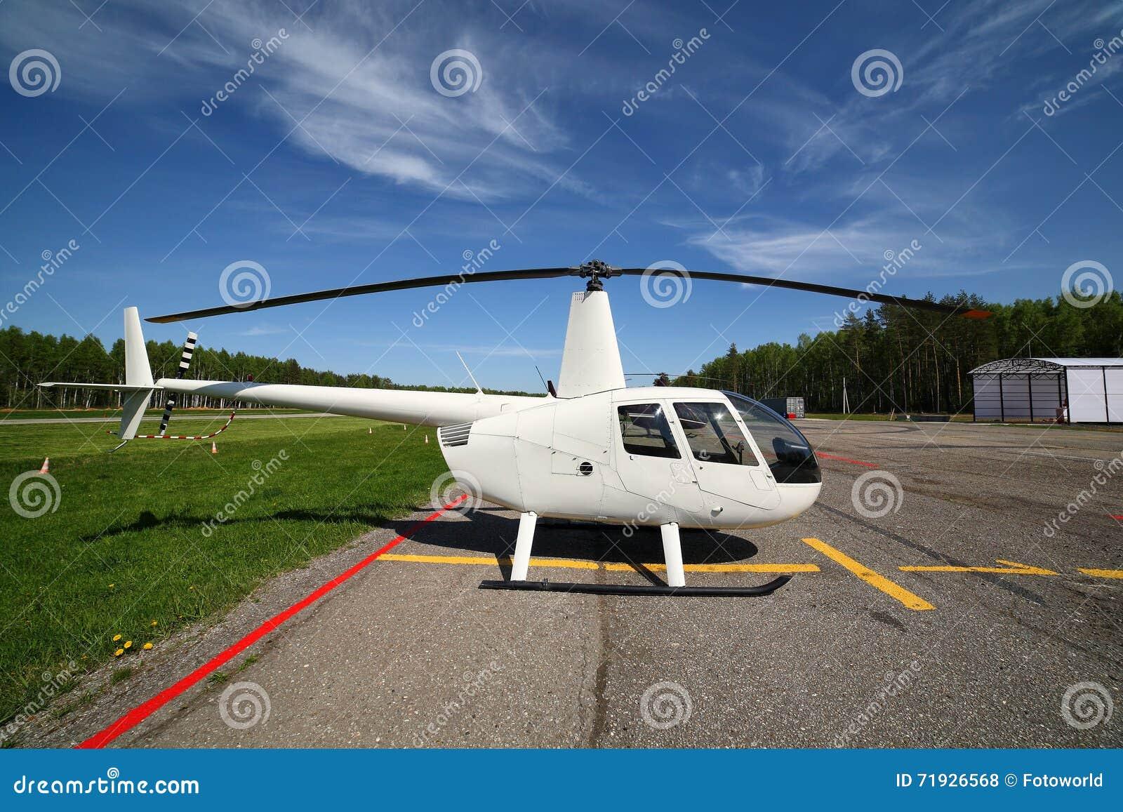 Воздушные судн - малый белый вертолет