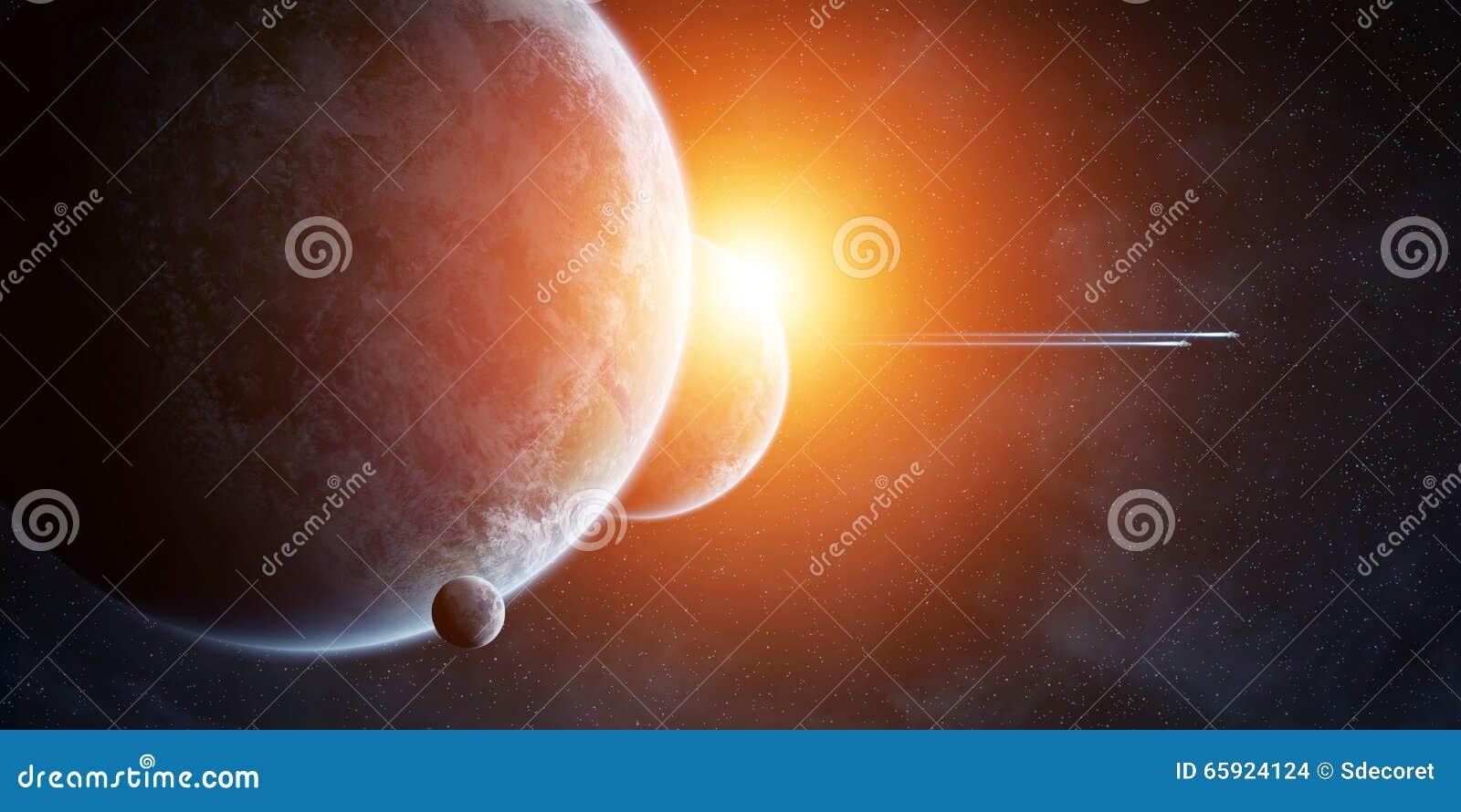 Восход солнца над планетами в космосе