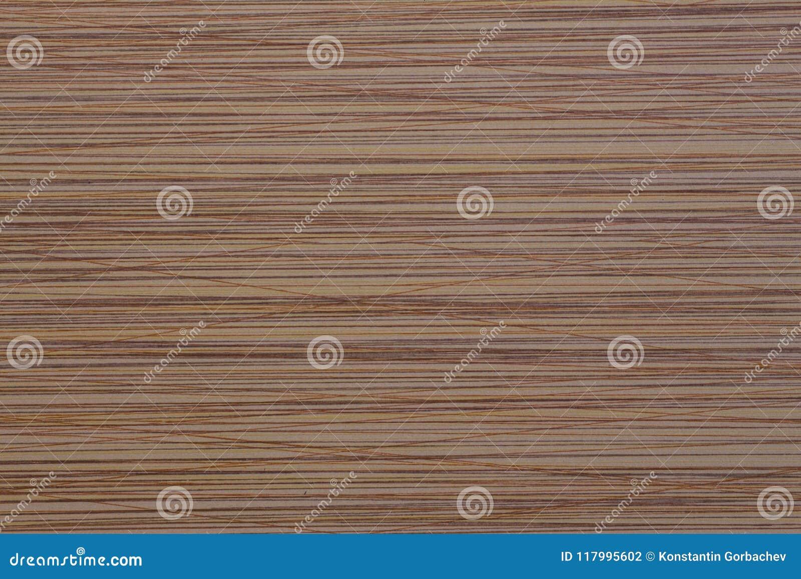 Выбитая поверхность коричневого цвета текстуры с хаотическими нашивками
