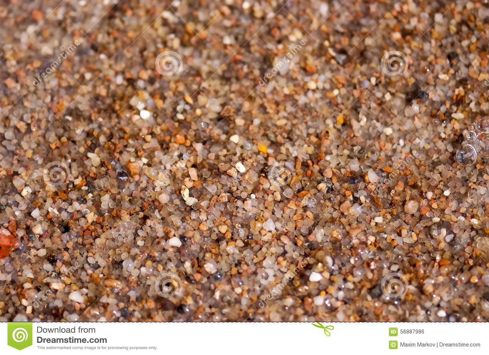 Влажный песок моря, конец вверх по взгляду