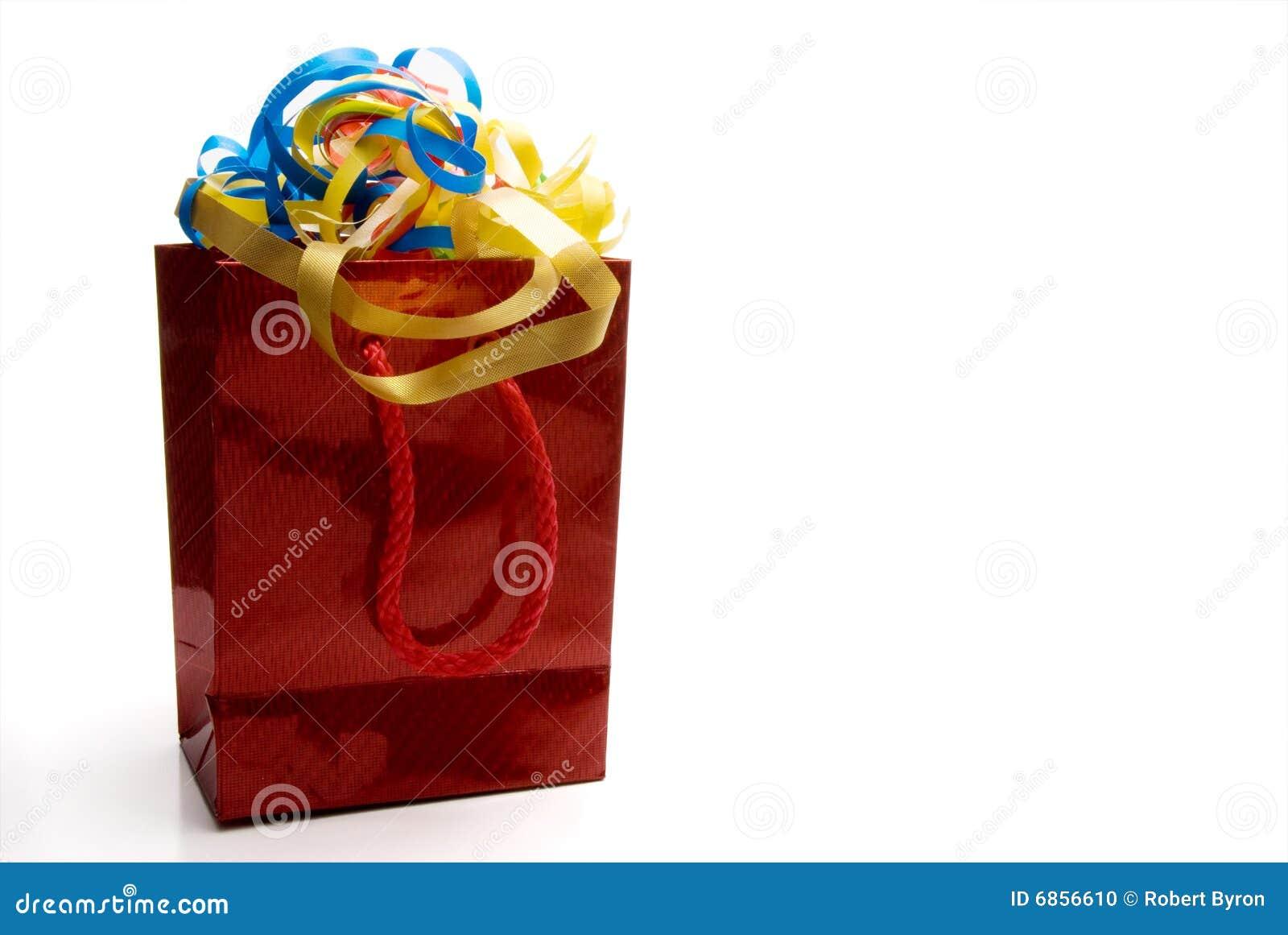 Глянцеватые красные мешок и тесемки подарка