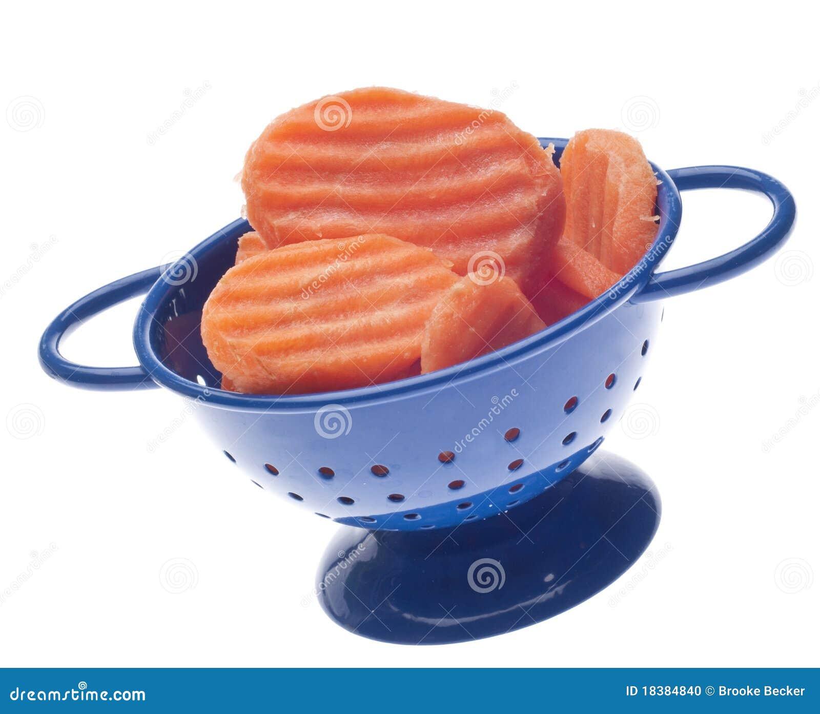 голубые ломтики colander моркови
