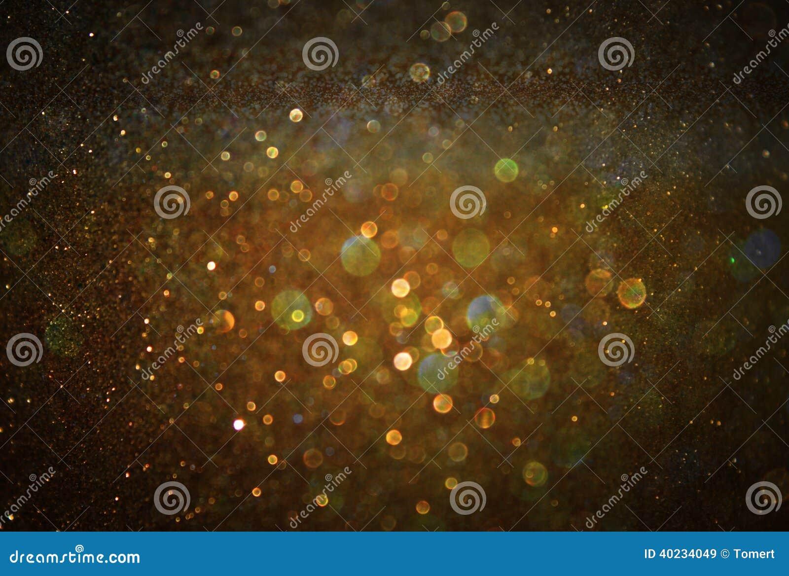 Год сбора винограда яркого блеска освещает предпосылку светлое золото и чернота