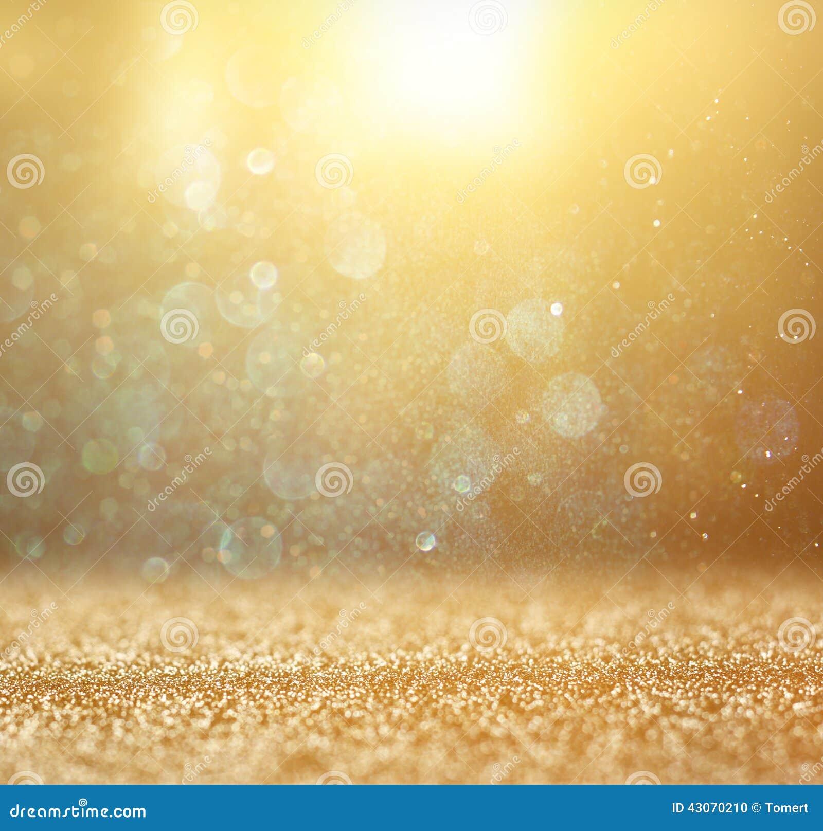 Год сбора винограда яркого блеска освещает предпосылку светлое золото и чернота defocused