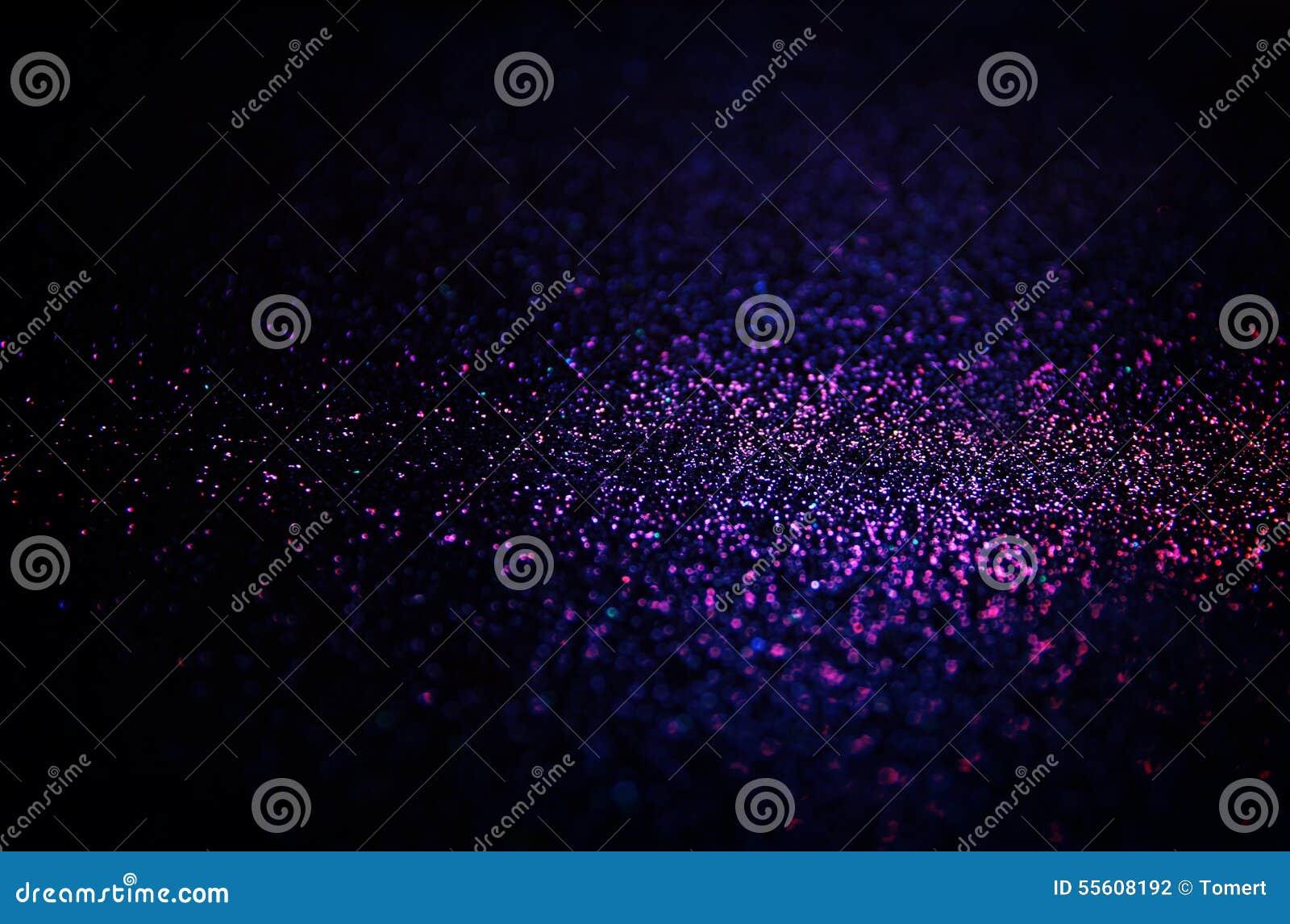 Год сбора винограда яркого блеска освещает предпосылку светлые серебр, золото, пурпур и чернота defocused