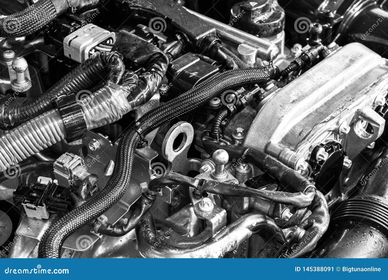 Двигатель автомобиля Машинная часть автомобиля Изображение конца-вверх двигателя внутреннего сгорания Двигатель детализируя в нов
