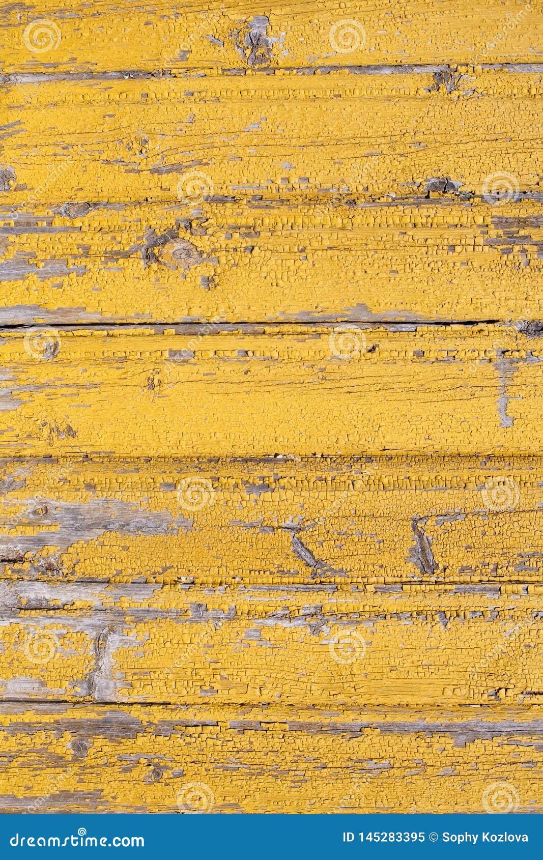 Деревенская деревянная старая шелушить желтая покрашенная текстура pl