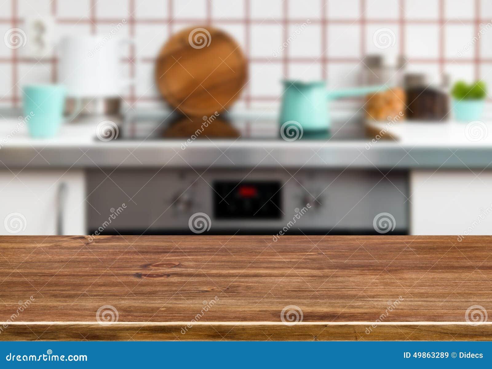 Деревянная таблица текстуры на предпосылке стенда плиты кухни