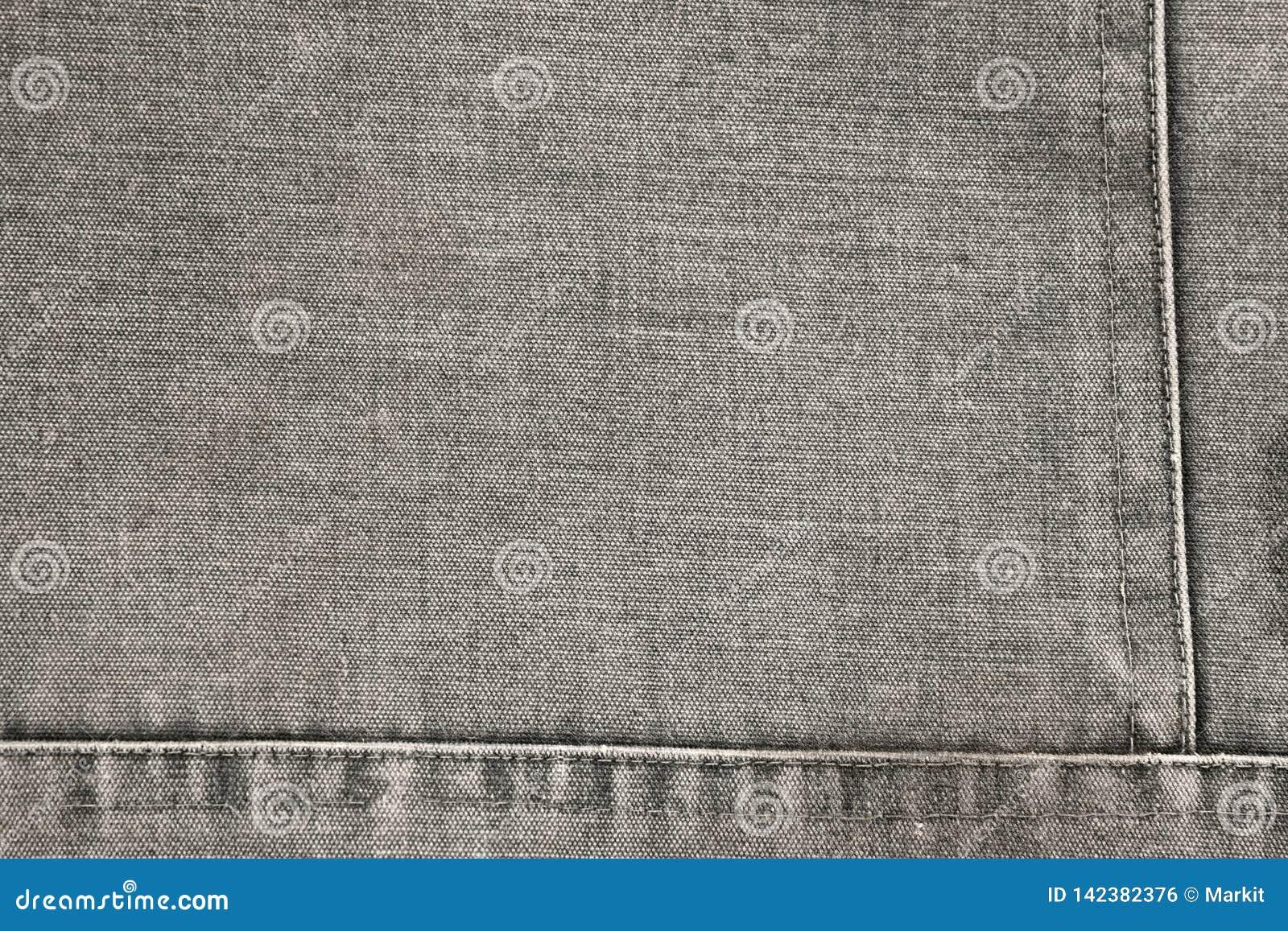 Деталь устарелой серой ткани