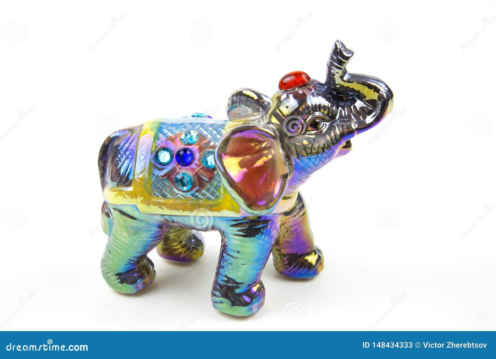 Диаграмма слона сделанного керамики украшена с покрашенными вставками mother-of-pearl бирюзы красок пурпурными серебряными col