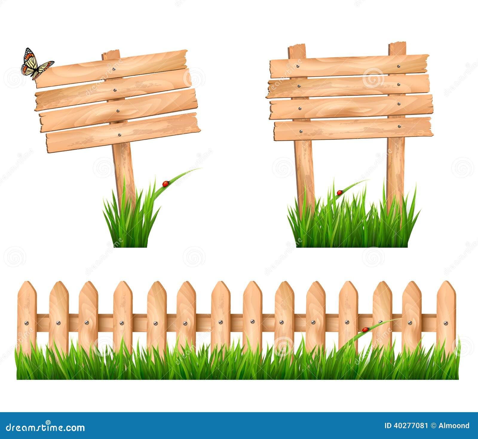 2 деревянных знака и загородка с травой.