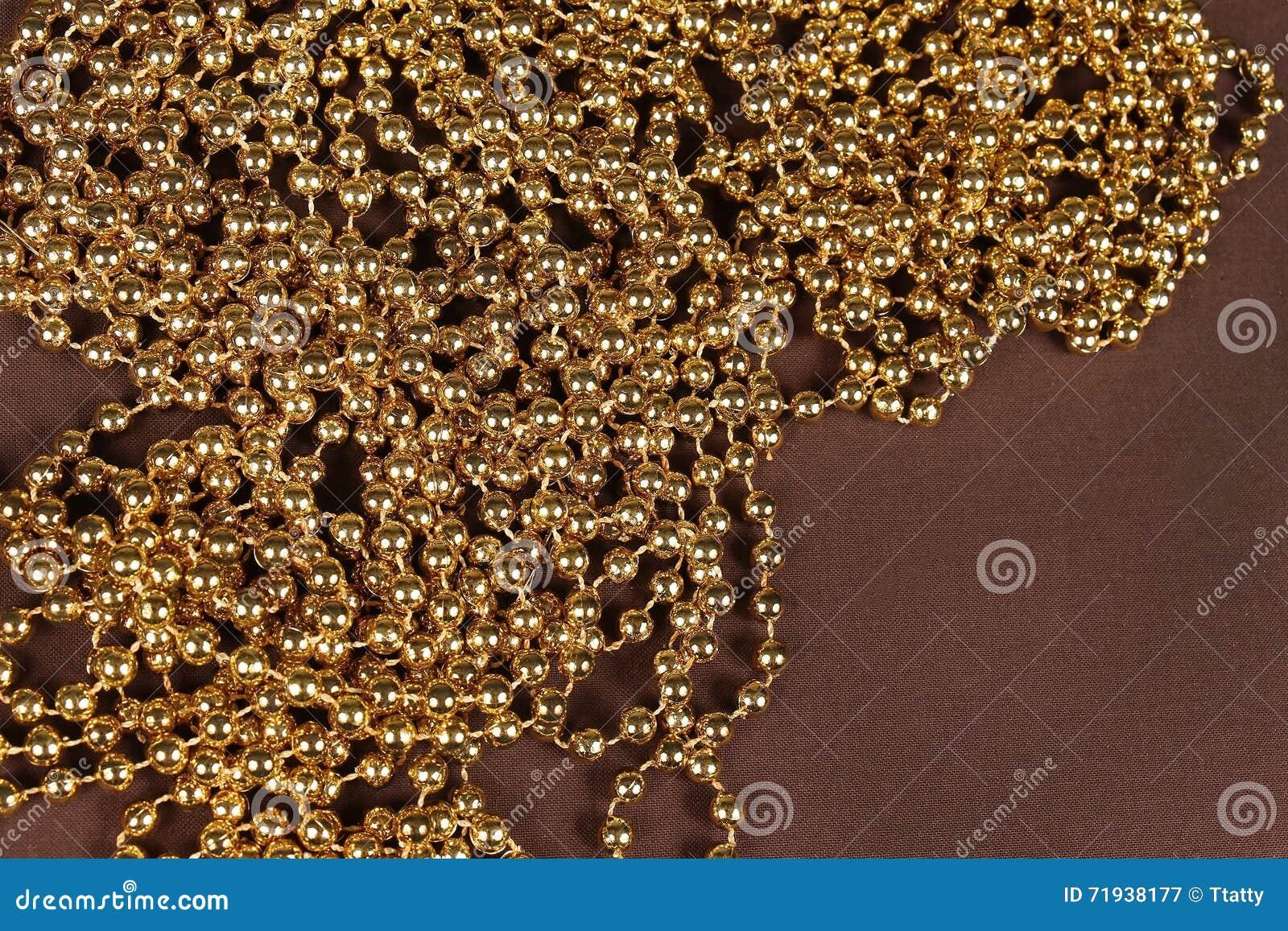 Жемчуга золота
