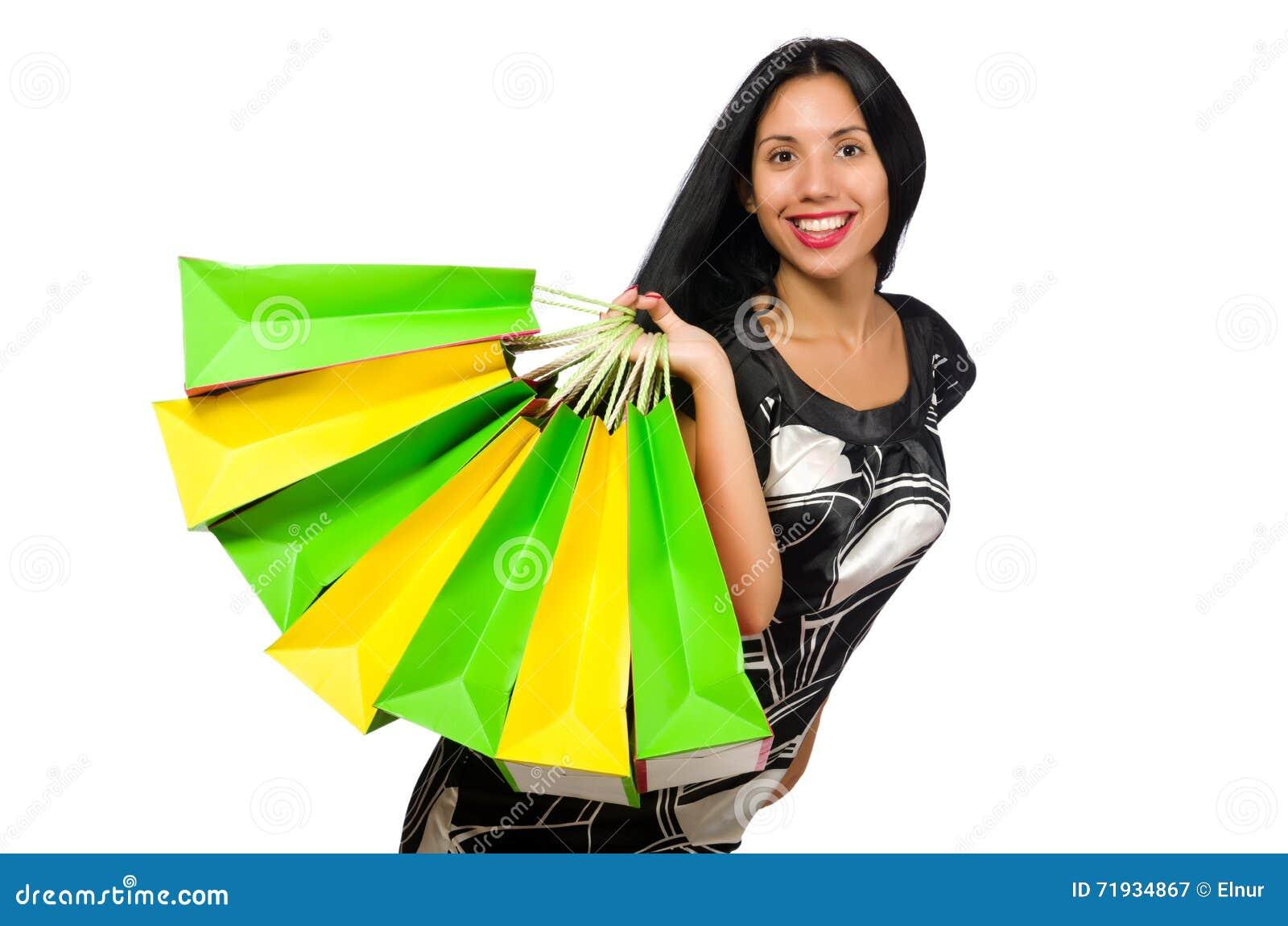 Женщина при хозяйственные сумки изолированные на белизне