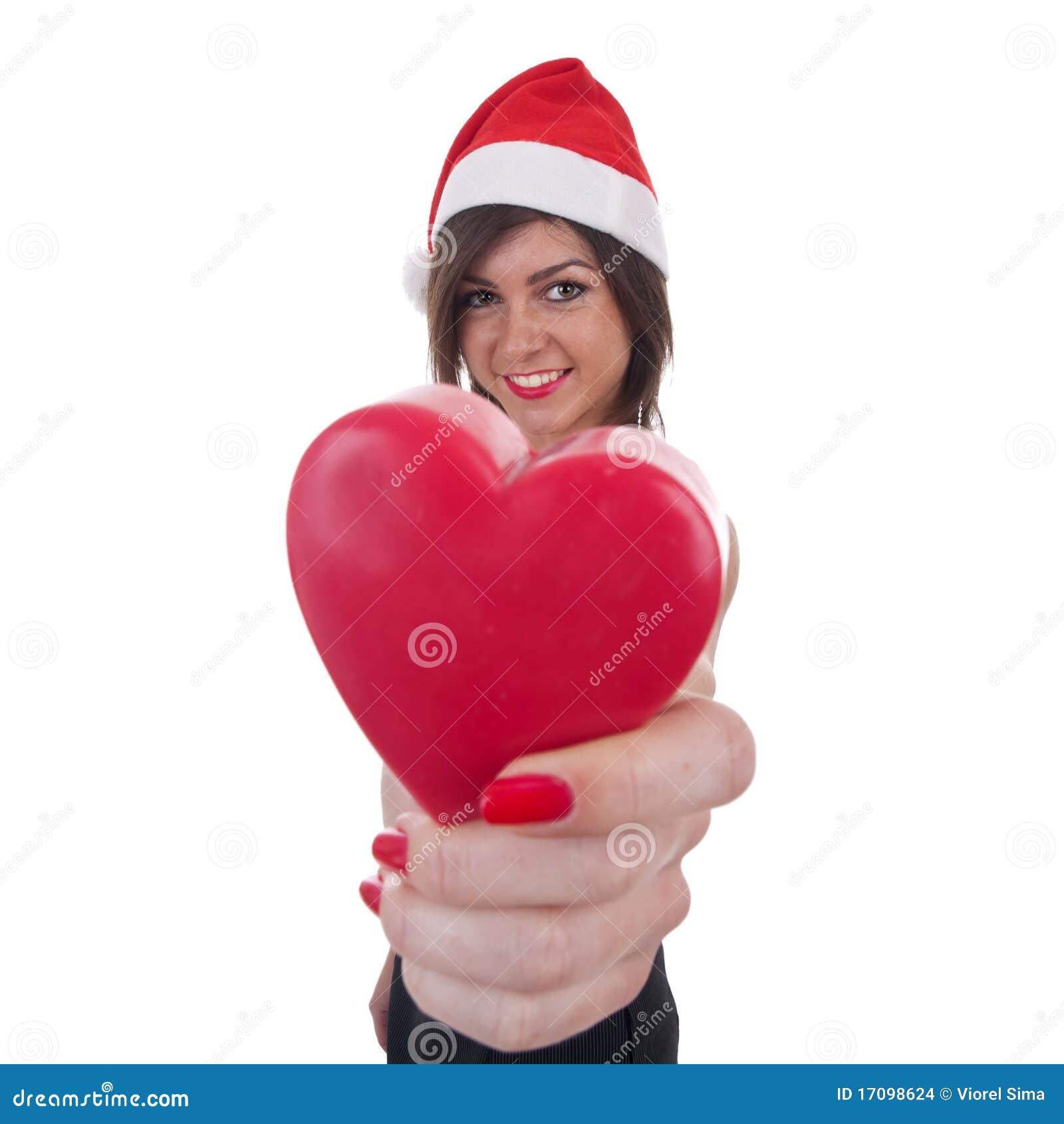 женщина santa удерживания сердца шлема
