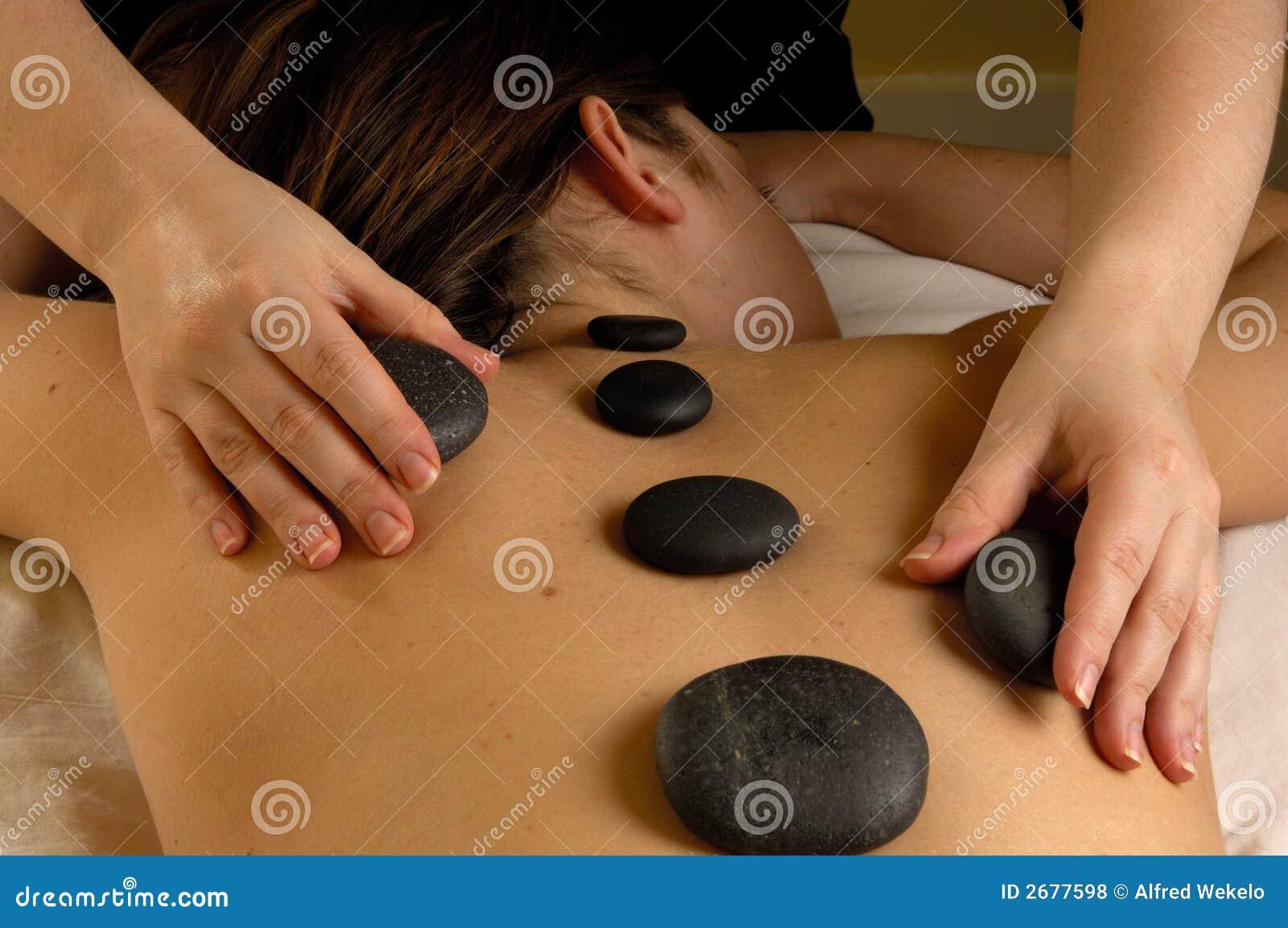 задний горячий камень минерала массажа
