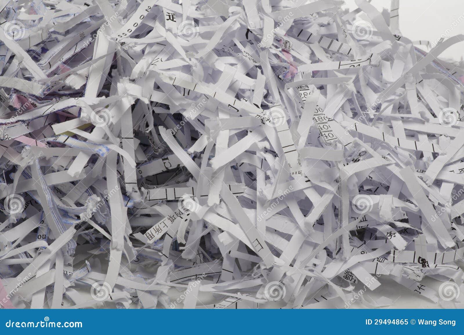 Закройте вверх shredded бумаги для предпосылки.