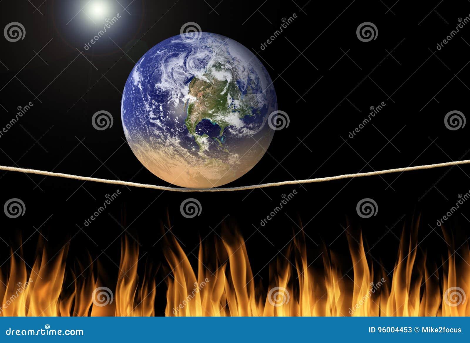 Заройте балансировать на опасном положении над сообщением изменения климата огня экологическим