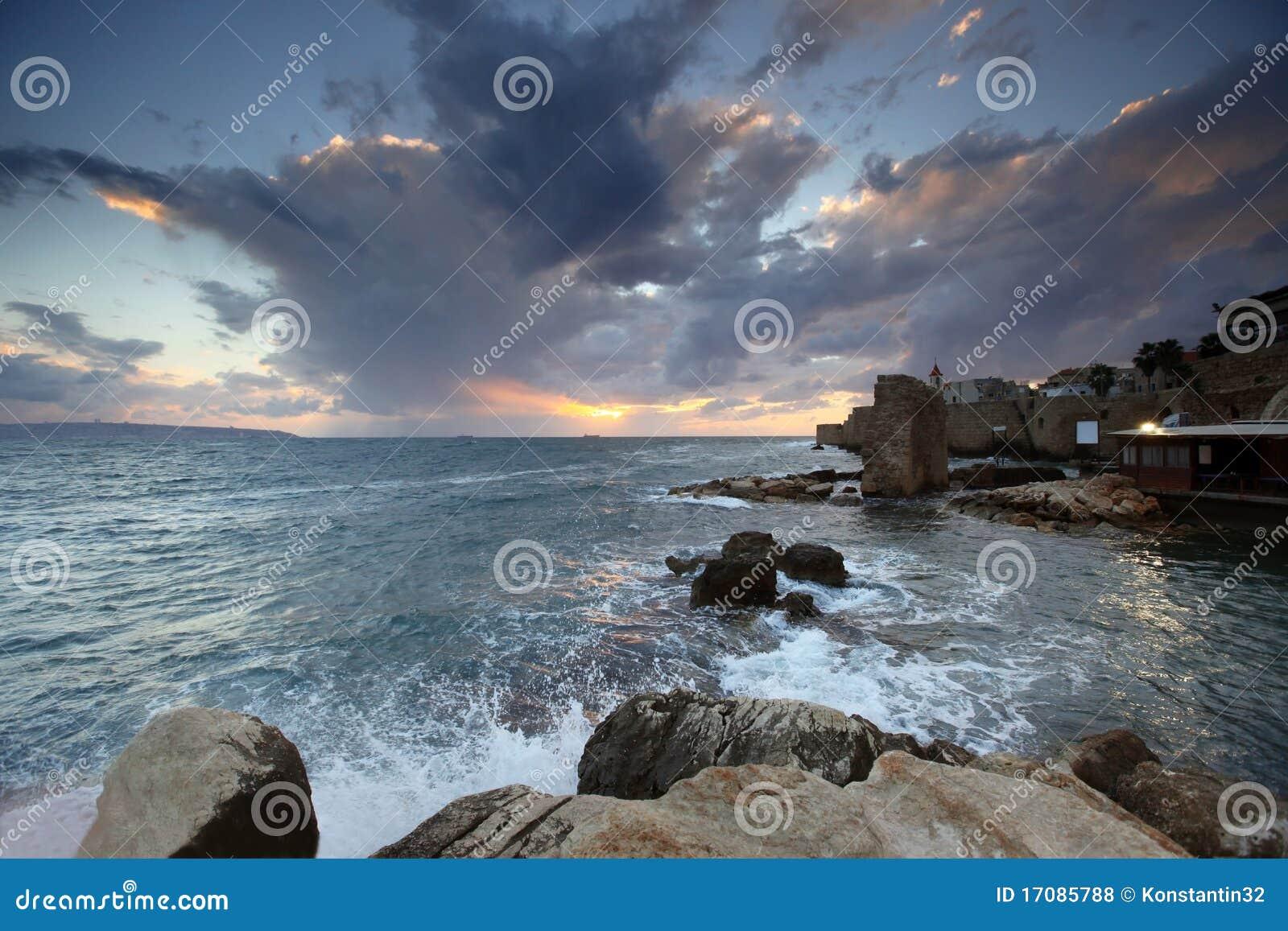 заход солнца города акра среднеземноморской