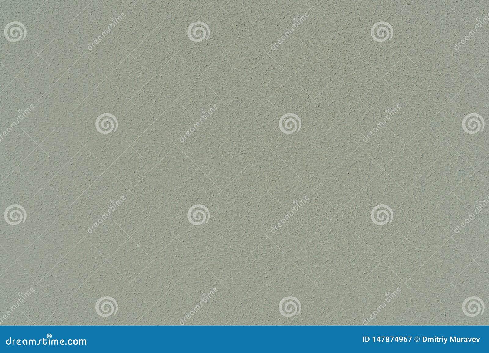 Заштукатуренная бетонная стена, покрашенная в сер-зеленой, поверхностной текстуре