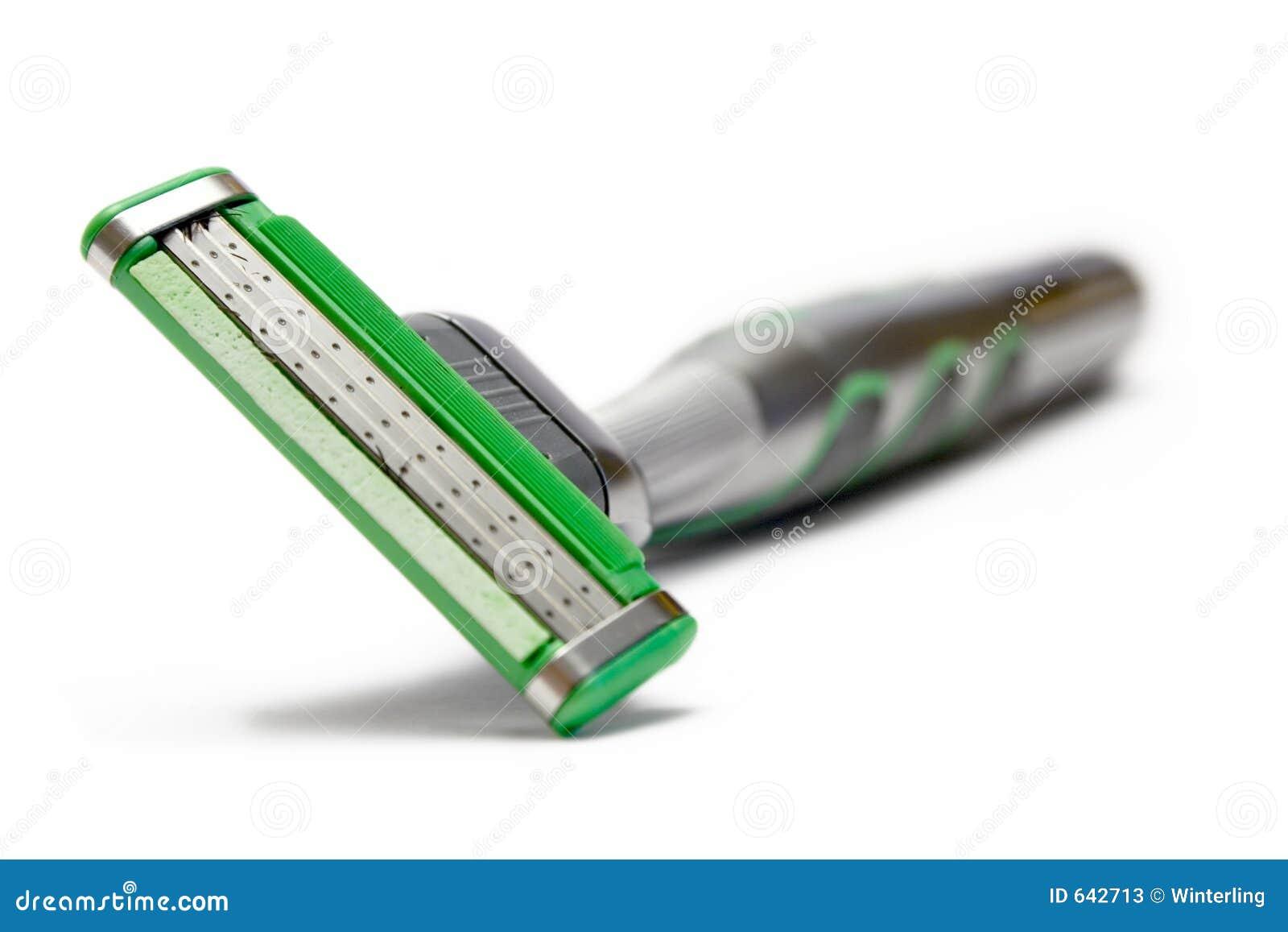 Download зеленая бритва стоковое изображение. изображение насчитывающей бритва - 642713