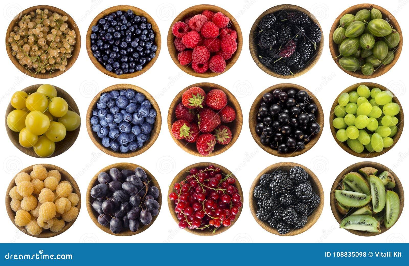 Зеленая, желтая, красная, голубая и черная еда ягоды изолировали белизну Коллаж плодоовощей и ягод других цветов на задней части