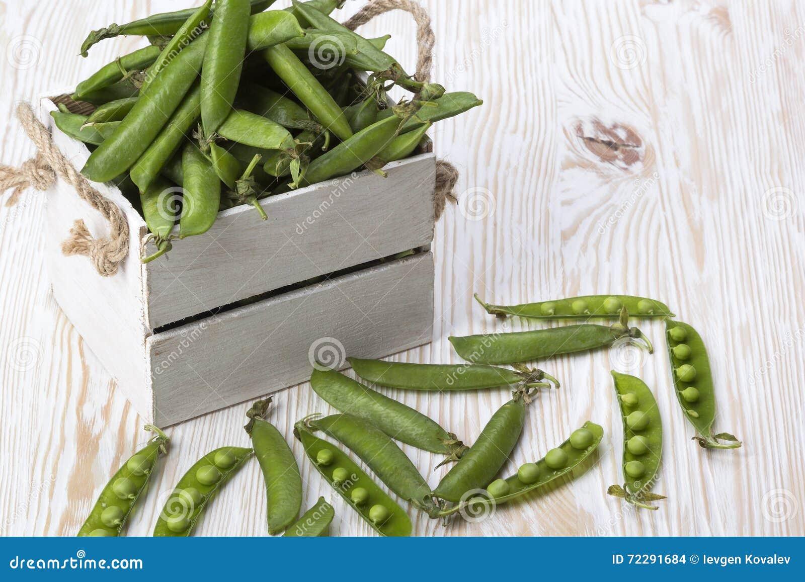 Download Зеленые горохи в деревянной коробке Стоковое Фото - изображение насчитывающей лодочника, здорово: 72291684