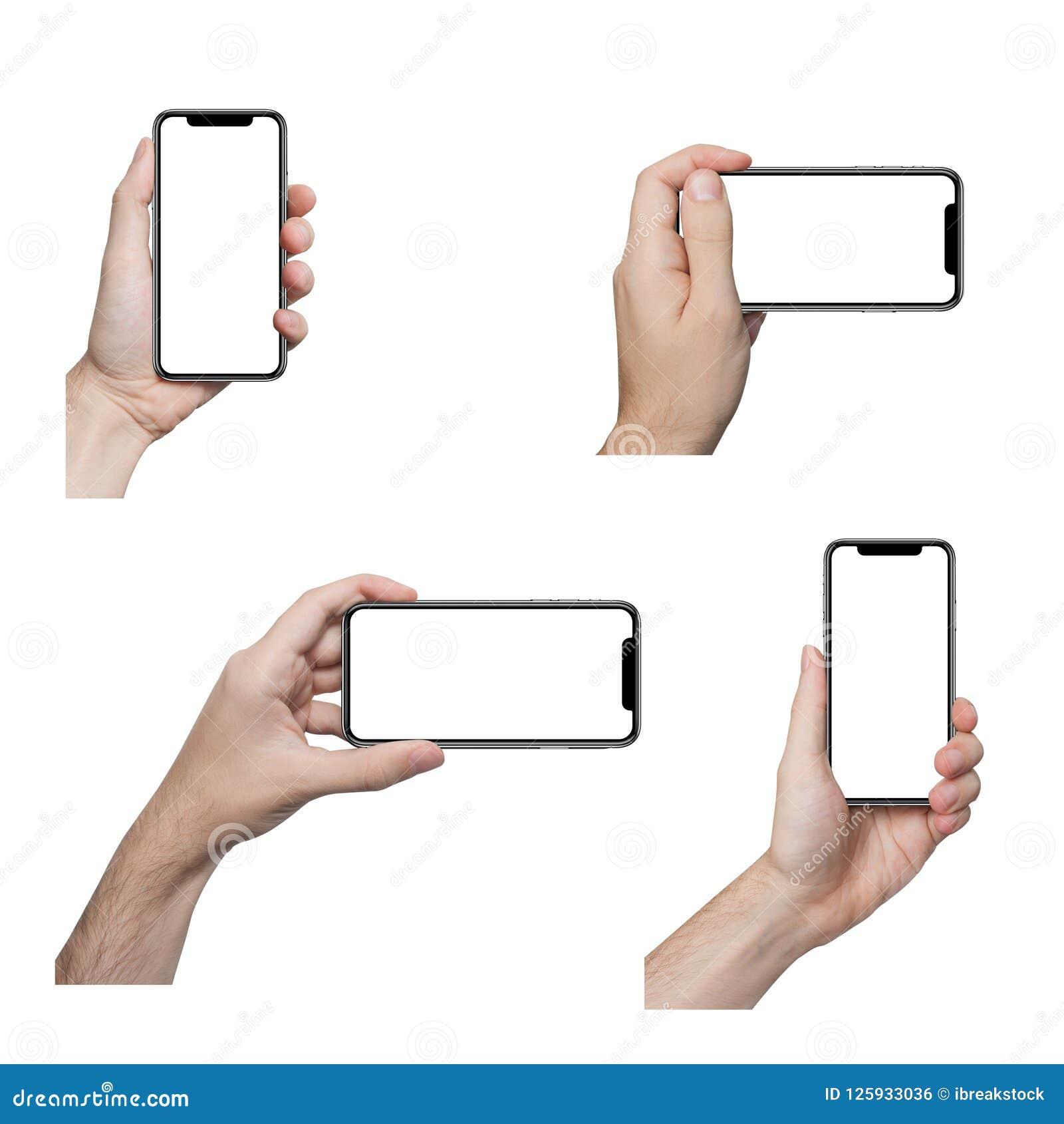 Изолированные мужские руки держа телефон