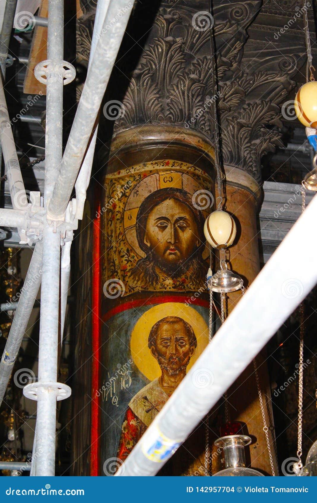 Иисус Христос на штендере в великолепной базилике рождества Christ's в Вифлееме