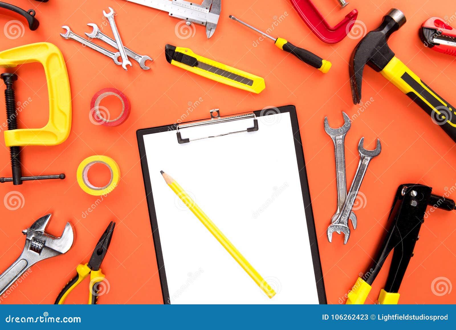 Инструменты доски сзажимом для бумаги и reparement