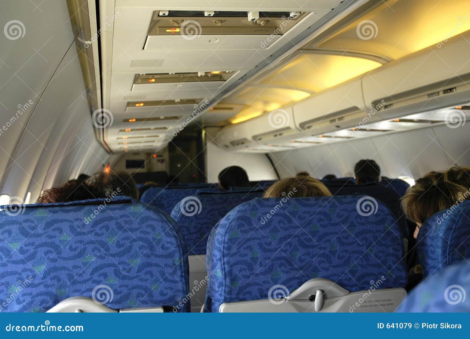 Download интерьер самолета стоковое изображение. изображение насчитывающей люди - 641079