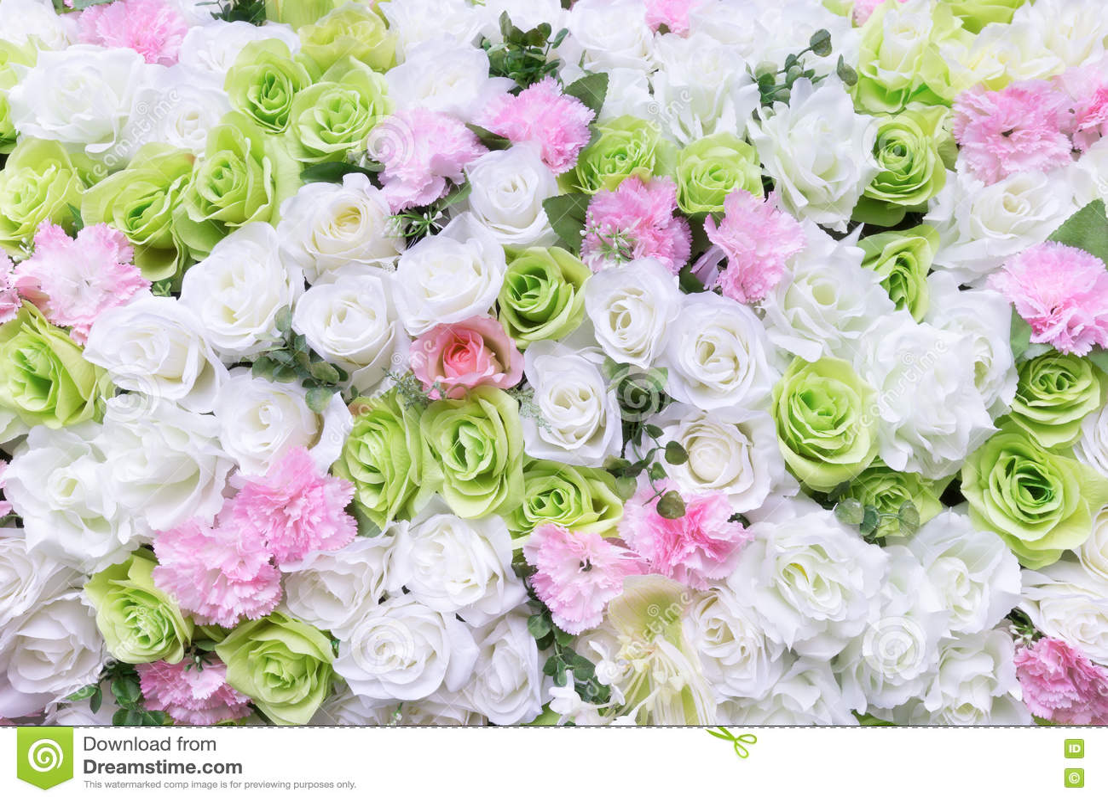 Искусственная красочная роза цветет предпосылка