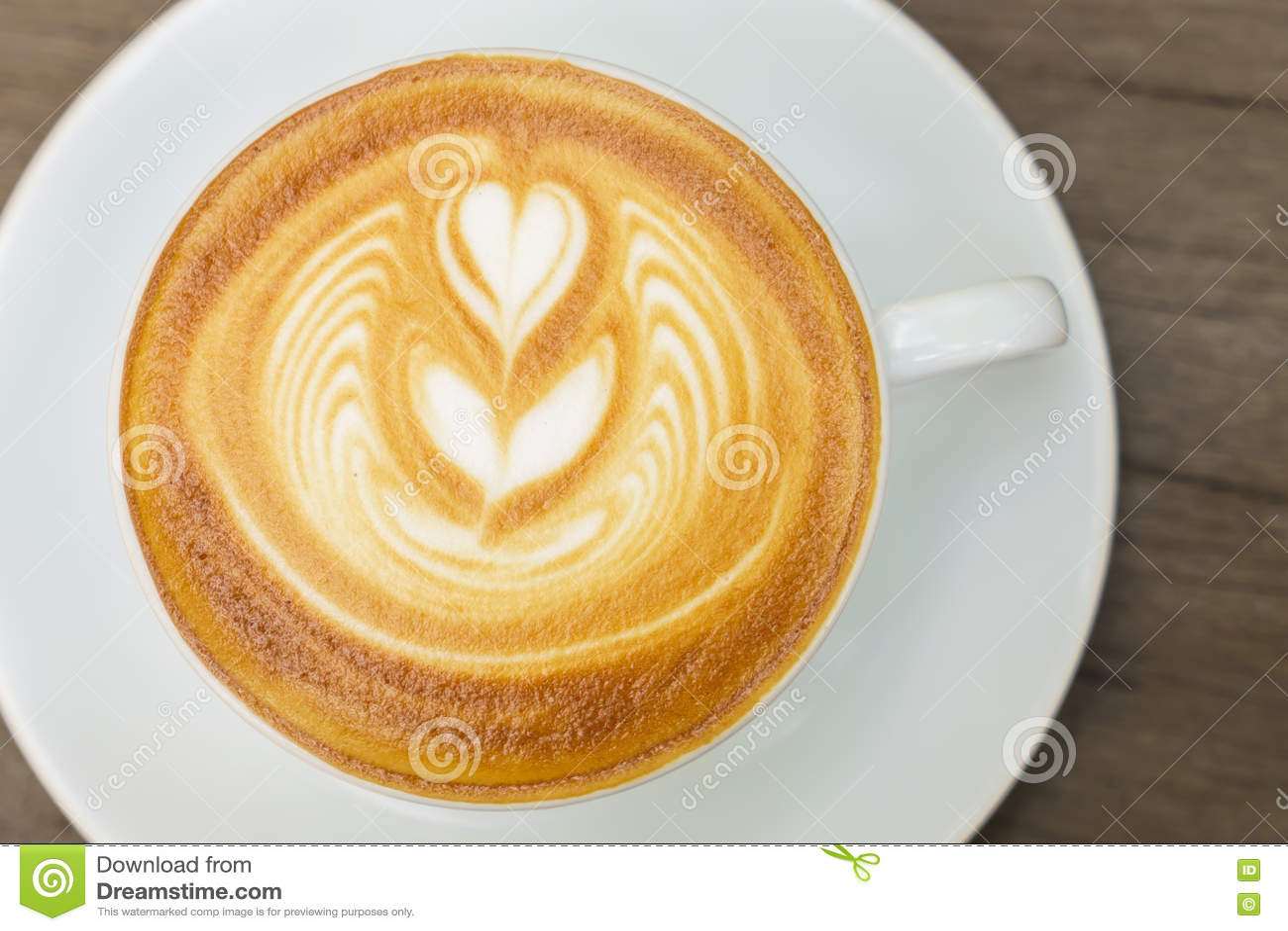 Download Искусство кофе Latte на деревянном столе Стоковое Фото - изображение насчитывающей стол, сердце: 72286298