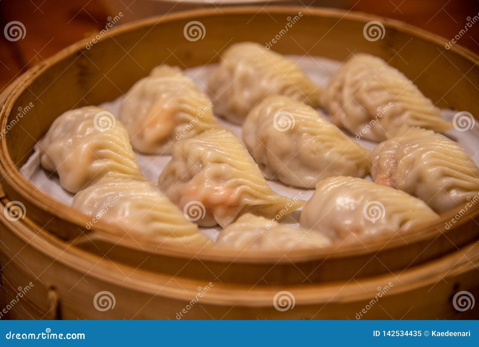 испаренные вареники Звезда каталога Мишлен наградила Din Tai Fung выстроена в ряд как один из ресторана 10 лучших мира самого луч